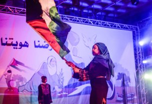 Children perform a musical named 'Photographs' during the commemoration titled 'Our Land is Our Identity', organized by Culture and Free Thought Association (CFTA) of Palestine, as part of 41st Palestinian Land Day at The Rashad Shawa Cultural Center in Gaza City, Gaza on March 29, 2017 (Mustafa Hassona - Anadolu Agency )