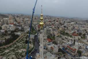 The construction of the tallest minaret in Jerusalem on 17 March 2017 [Mostafa Alkharouf/Anadolu]