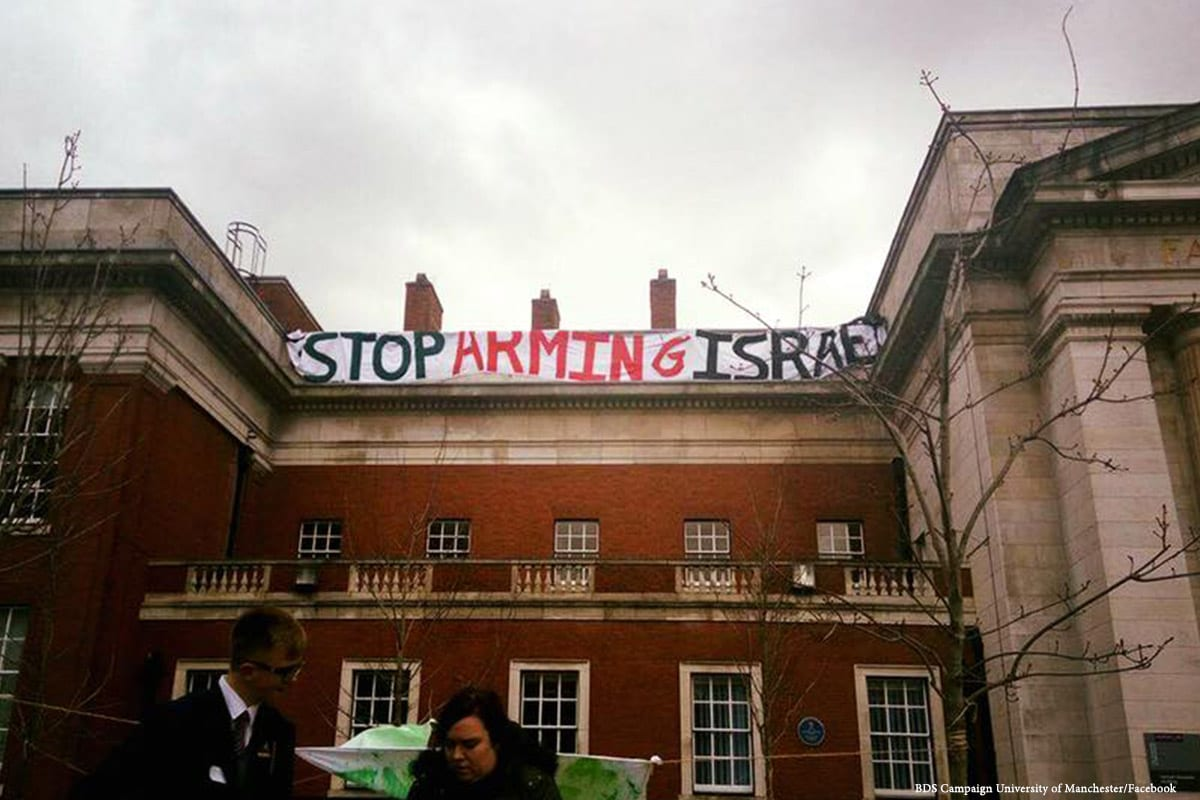 Image of a banner reading 'Stop Arming Israel' during Israel Apartheid Week by the student-led BDS campaign at the University of Manchester on 3 March 2017 [BDS Campaign University of Manchester/Facebook]