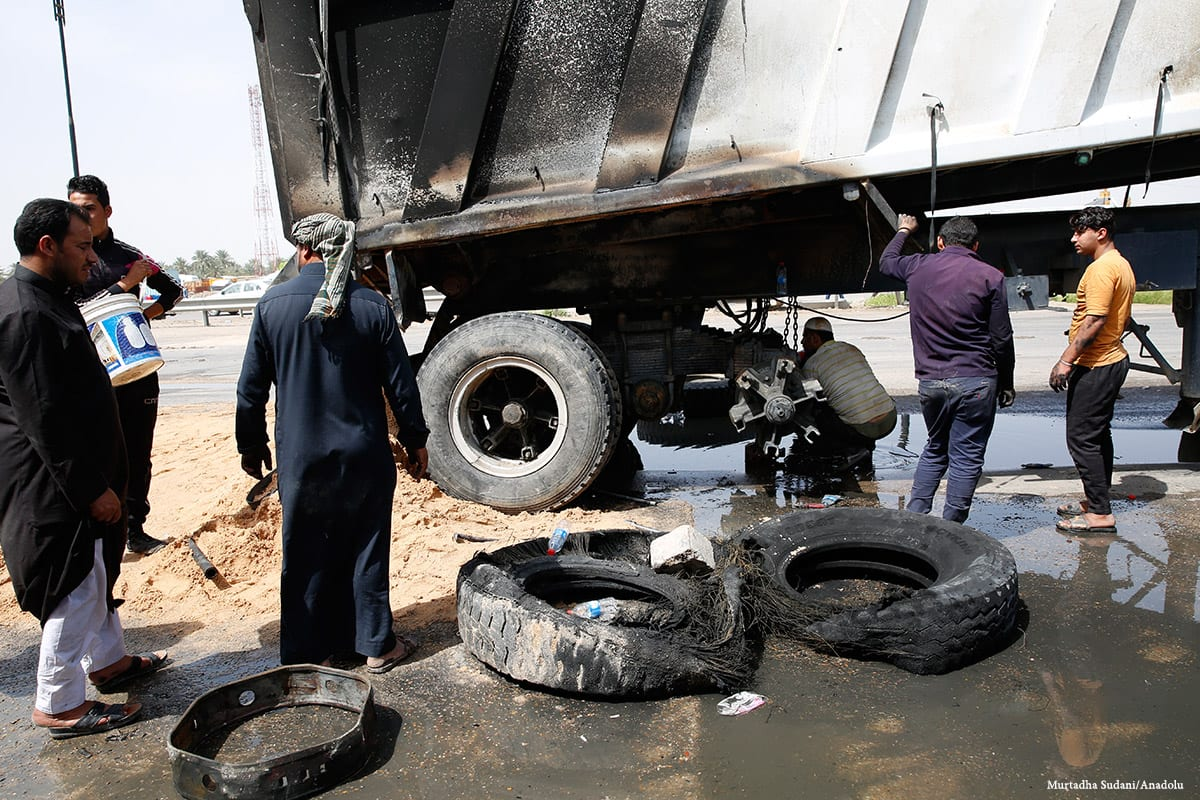 Workers clean the wreckage of a terrorist car bomb attack in Baghdad, Iraq on 30 March 2017 [Murtadha Sudani/Anadolu]