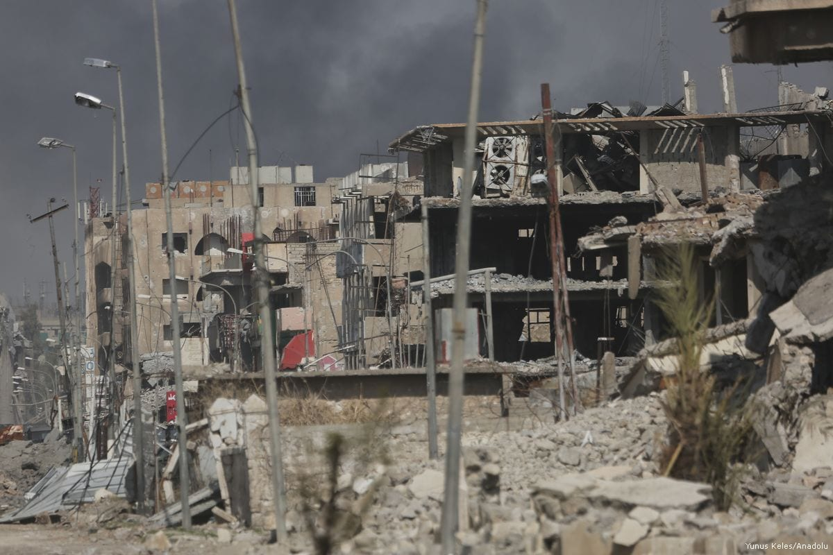 Damaged buildings are seen after clashes between Iraqi army and Daesh terrorists as the operation to retake Iraq's Mosul from Daesh terrorists continues on 7 March 2017 [Yunus Keleş - Anadolu Agency]