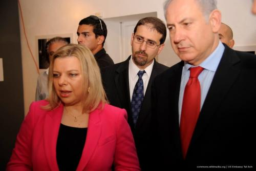 Israeli Prime Minister Benjamin Netanyahu attends a photo exhibition with his wife, Sara Netanyahu