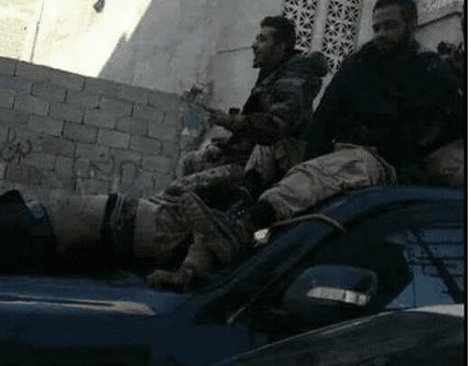 Libyan Army General Khalifa Haftar's army exhumes body of Benghazi Shura Council commander Jalal Makhzoum from his Ganfouda grave and disfigures him on 18 March 2017 [The Libya Observer/Twitter]