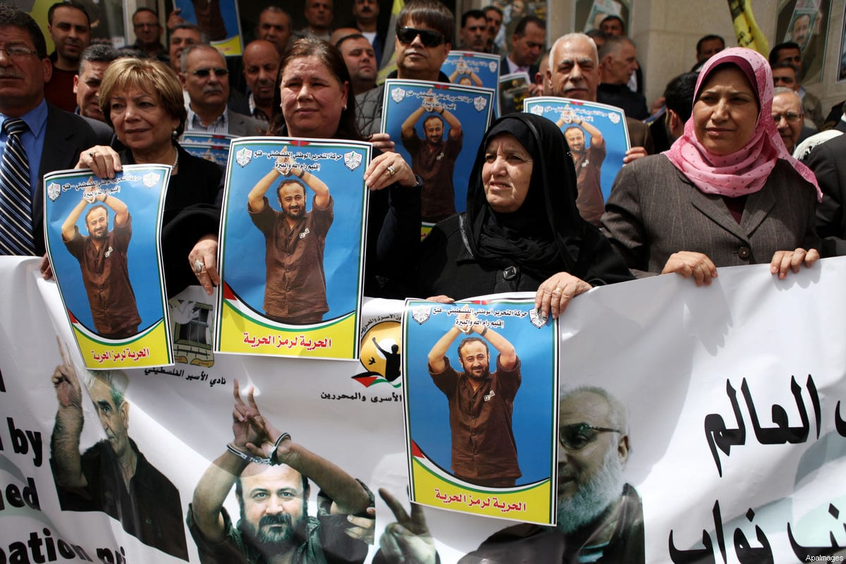 Palestinians hold portraits of jailed Fatah leader Marwan Barghouti during a protest demanding for his release form Israeli prison, outside the Palestinian legislative council in the West Bank city of Ramallah, April 15, 2015 [Shadi Hatem / ApaImages]