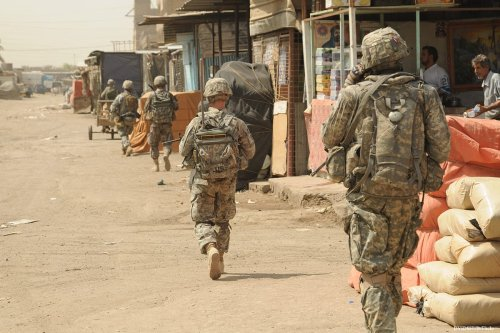 Image of US soldiers during the 2003 invasion in Baghdad, Iraq [DVIDSHUB/Flickr]