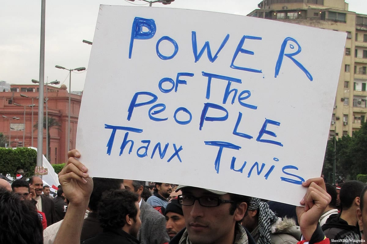 Tunisians hold placards and banners during the revolution that took place in January 2011 [Sherif9282/Wikipedia]