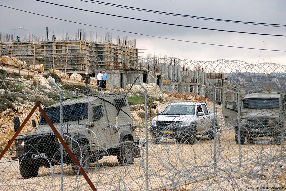 Image of Israeli military authorities and personals standing guard in West Bank [Najeh Hashlamoun/Apaimages]