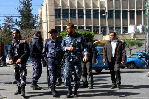 Image of armed Palestinian Hamas security members [Ashraf Amra/Apaimages]