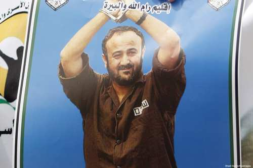Image of a poster depicting the portrait of jailed Fatah leader Marwan Barghouti during a protest on 14 April 2015 [Shadi Hatem/Apaimages]