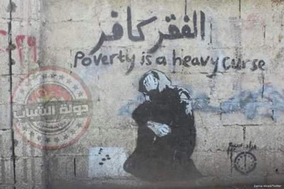 Graffiti work illustrating a woman living in poverty in Egypt [Samia elsaid/Twitter]