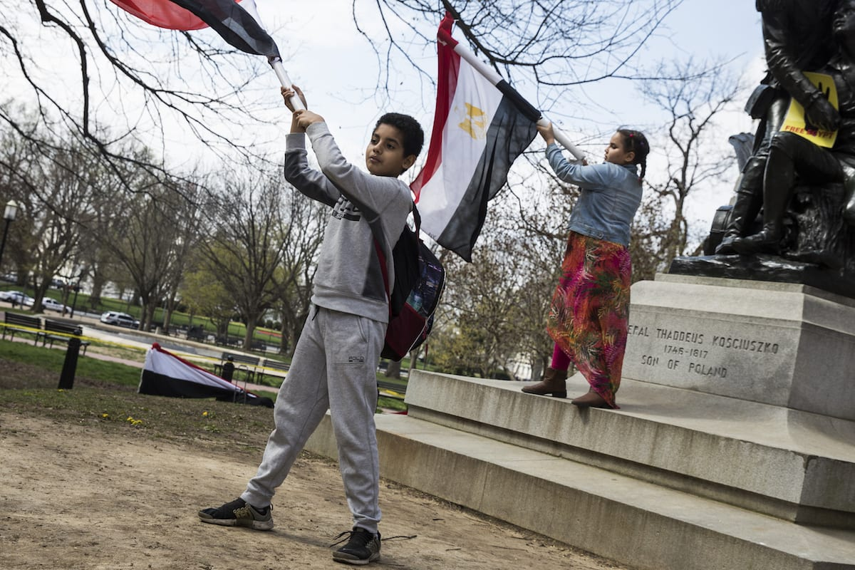 Egyptian American children wave flags protesting Egyptian President Abdulfettah el-Sisi's meetings with U.S. President Donald Trump at the White House in Washington, USA on April 3, 2017 [Samuel Corum/Anadolu Agency]