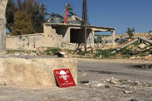 A poison hazard danger sign is seen after the Assad regime carried out a chemical attack in Idlib Syria on 5 April 2017 [Ogün Duru / Anadolu Agency]