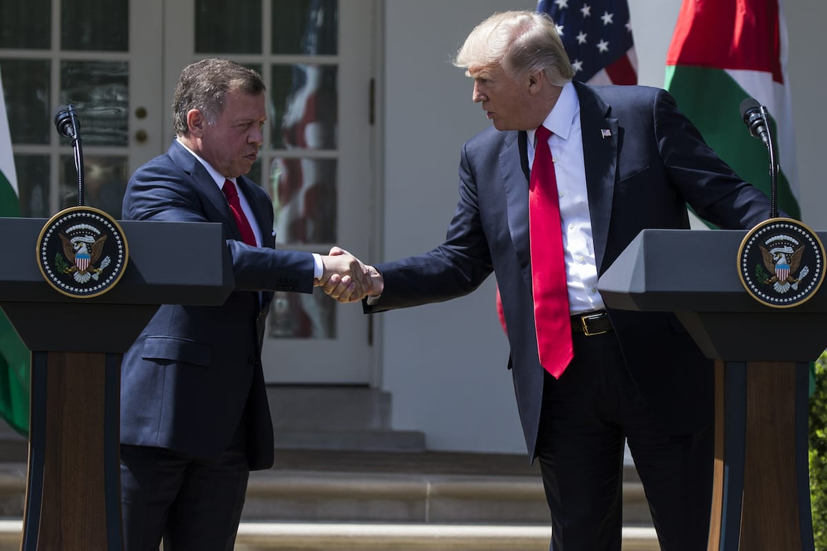 US President Donald Trump and King Abdullah II bin al-Hussein of Jordan shake hands during a joint press conference in Washington, US on 5 April 2017 [Samuel Corum/Anadolu Agency]