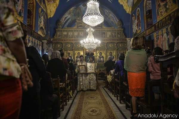 GAZA CITY, GAZA - APRIL 09: Orthodox Christians in Gaza attend the Palm Sunday celebrations at St. Porphyrios Church in Gaza City, Gaza on April 09, 2016. ( Mustafa Hassona - Anadolu Agency )