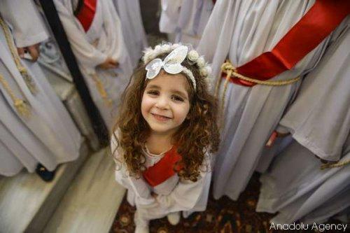 Orthodox Christians in Gaza attend the Palm Sunday celebrations at St. Porphyrios Church in Gaza City, Gaza on 9 April, 2016 [Mustafa Hassona/Anadolu Agency]