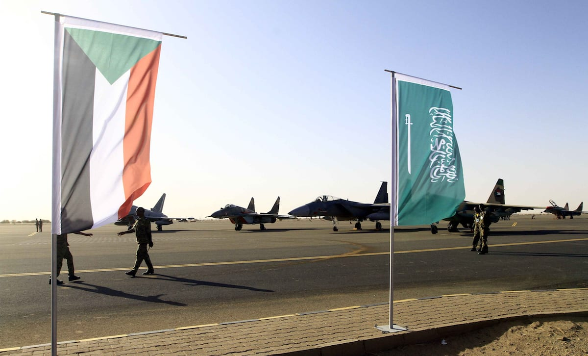 Image of Saudi Arabia and Yemen flags [Ebrahim Hamid/Anadolu Agency]