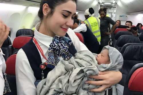 Turkish Airline cabin crew hold the newborn baby girl, Kadiju Diaby. Image: Twitter/TurkishAirlines