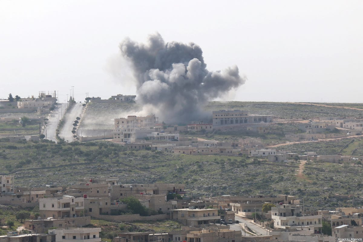 Smoke rises after the war crafts belong to Assad Regime forces carried out airstrikes on the Darat Izza district of Aleppo, Syria on April 22, 2017. [Mahmud Faisal/Anadolu Agency]