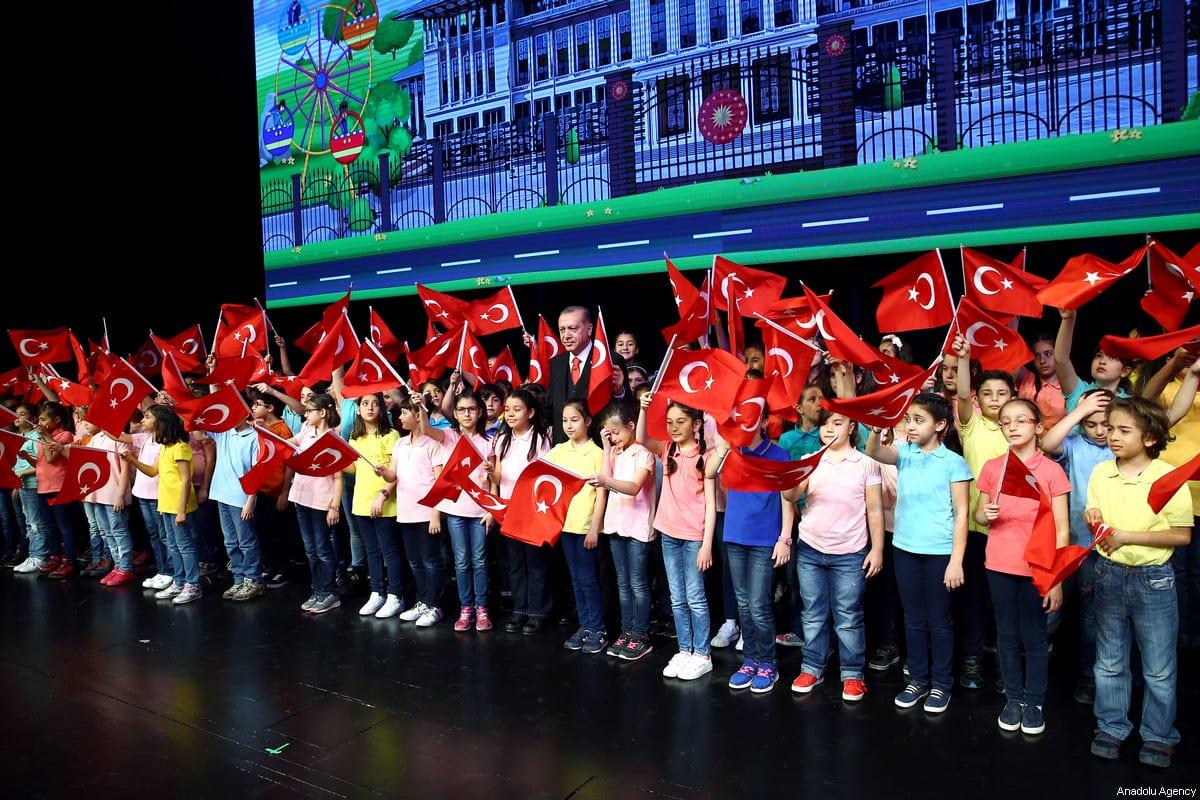 Turkish President Recep Tayyip Erdogan poses with children at Bestepe People's Culture and Congress Center in Ankara, Turkey on 23 April 2017 [Kayhan Özer/Anadolu Agency]
