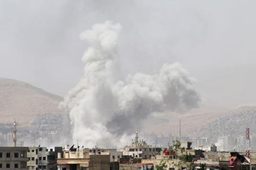Smoke rises from residential areas after Assad regime's airstrike in Qaboun Neighborhood of Damascus, Syria on 28 April 2017. ( Samir Tatin - Anadolu Agency )