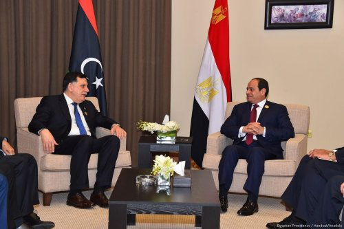 Chairman of the Presidential Council of Libya, Fayez al-Sarraj (L) meets Egyptian President Abdel Fattah el-Sisi (R) as part of the 28th Arab League Summit in Amman, Jordan on 29 March, 2017 [Egyptian Presidency/Handout /Anadolu Agency]