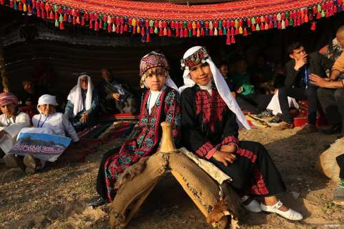GAZA CITY, GAZA - Palestinian Bedouin girls wear traditional clothes during a rally marking the 41st anniversary of Land Day, in Deir el-Balah. Land Day marks the country-wide revolt of Palestinians in response to Israel announcing the mass confiscation of Palestinian land.