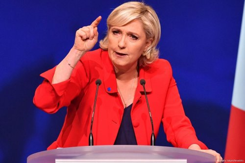 Marine Le Pen, the leader of France's far-right Front National (FN) party delivers a speech during a campaign meeting in Paris, France on 17 April 2017 [Mustafa Yalçın/Anadolu Agency]