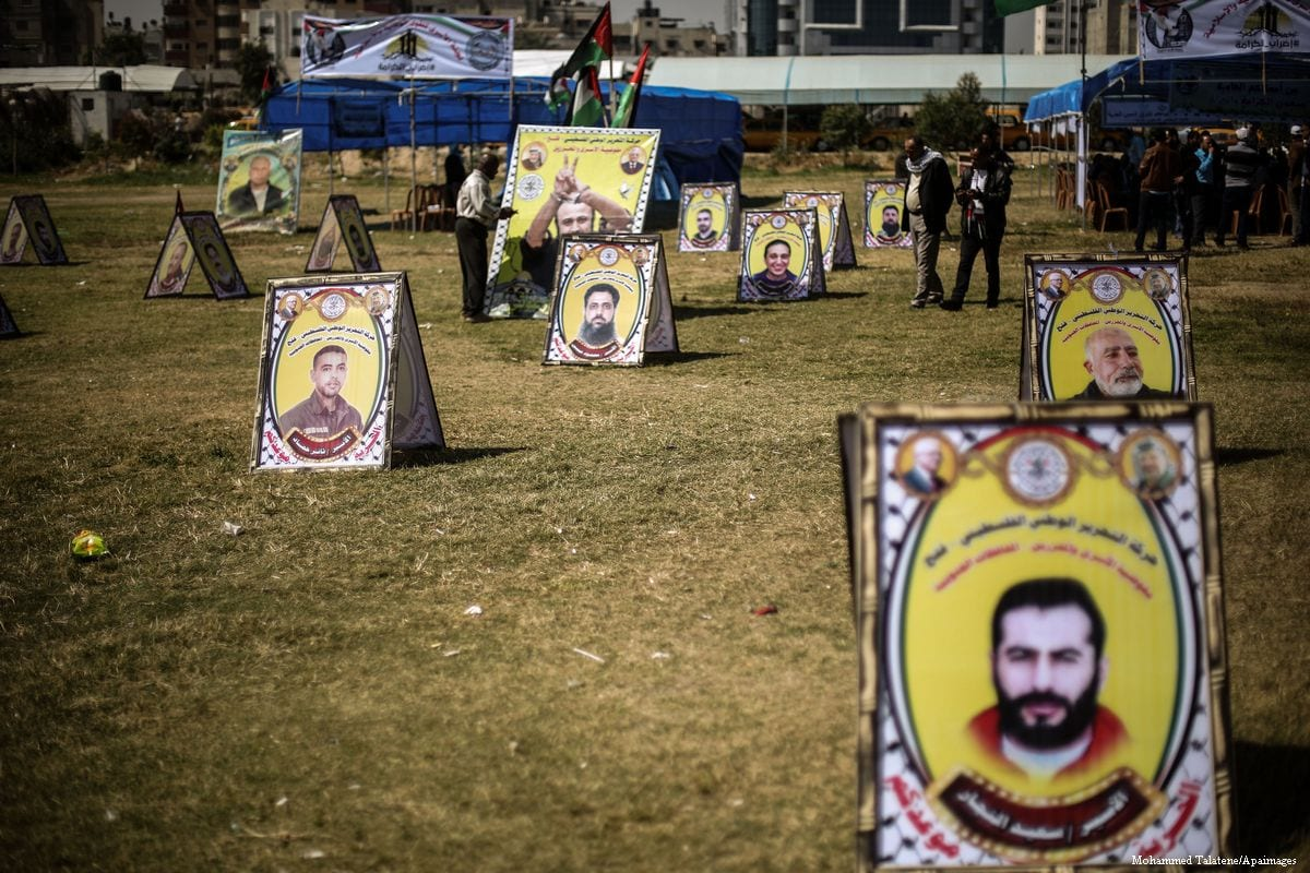 Placards are placed during a demonstration in support of Palestinians who are on hunger strike in Israeli prisons, at Saraya Square in Gaza City, Gaza on April 19, 2017 [Mohammed Talatene/Anadolu Agency]