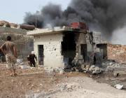 Civil defence team members extinguish a fire after an airstrike hit Idlib, Syria on 27 April 2017 [Bilal Baioush/Anadolu Agency]