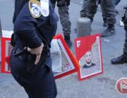 Posters confiscated by Israeli forces from Palestinians in Jerusalem at a protest showing solidarity with the 1,500 Palestinian prisoners on hunger strike in Israeli prisons, April 30, 2017 [Ma'an News]