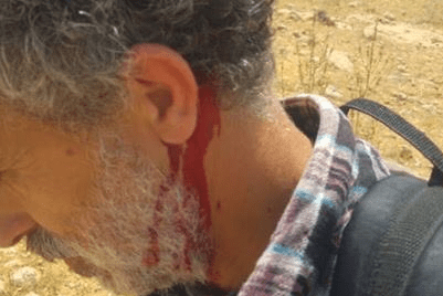 Israeli activists were attacked by illegal settlers in the occupied West Bank.