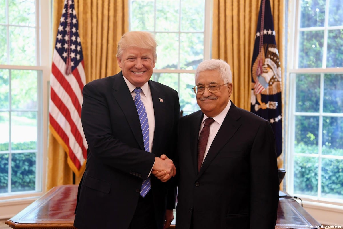US President Donald Trump shakes hands with Palestinian President Mahmoud Abbas during a meeting in the Oval Office of the White House on 3 May, 2017 in Washington, DC. [Thaer Ganaim/Apaimages]