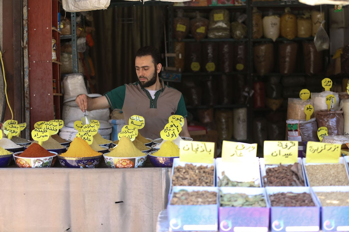 A Syrian muslim tradesman waits at his his shop before the Islamic holy month of Ramadan in Damascus, Syria on May 25, 2017 [Amer Almohibany / Anadolu Agency]