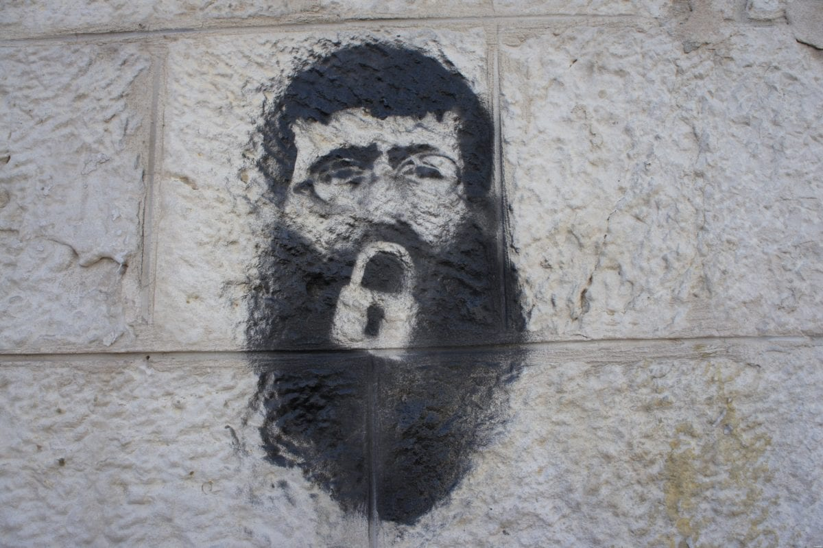 Khader Adnan stencil on a wall by Manara square, Ramallah on February 23, 2012 [Wikipedia]