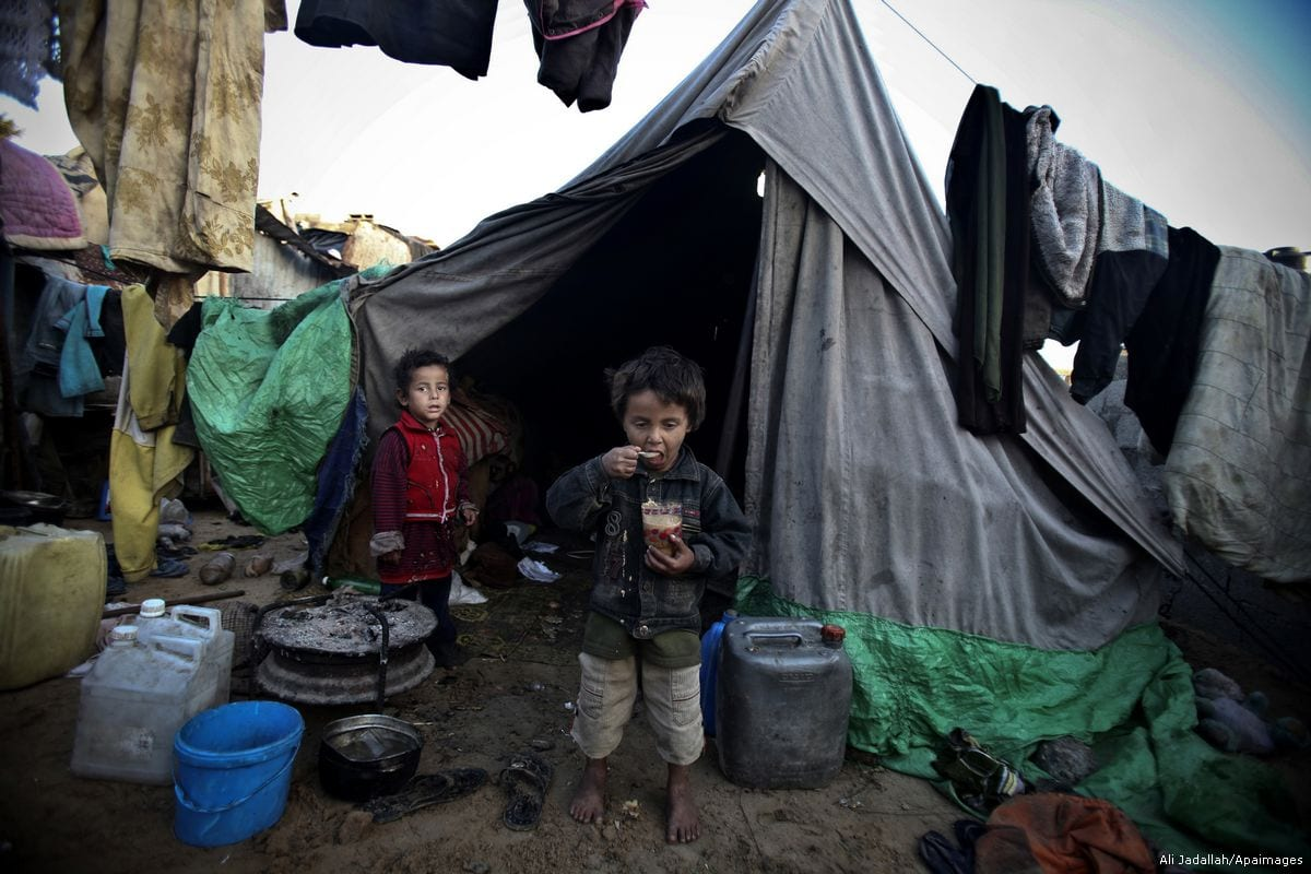Image of Palestinian children at their makeshift tent in Gaza on 24 January 2012 [Ali Jadallah/Apaimages]