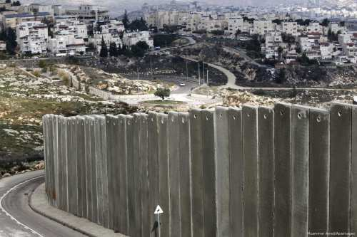 View of the Palestinian Shuafat refugee camp behind Israel's apartheid wall in east Jerusalem on 3 December 2014 [Muammar Awad/Apaimages]