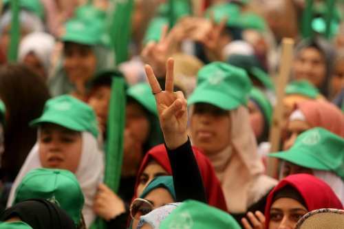 Students who support Hamas gather to attend the debate held ahead of the student council elections, at Bir Zeit University in Ramallah, West Bank on May 09, 2017 [Issam Rimawi / Anadolu Agency]