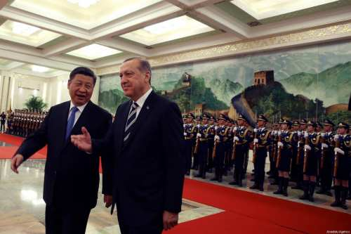 Turkish President Recep Tayyip Erdogan (R) and Chinese President Xi Jinping (L) walk past the honour guard during official welcome ceremony in Beijing, China on May 13, 2017 [Turkish Presidency / Yasin Bülbül / Anadolu Agency]