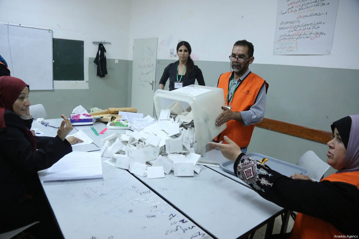 Officials prepare to count ballots after Palestinians living in West Bank voted in the local election, which is boycotted by several Palestinian groups, at the Banat Qasm High School in Ramallah, West Bank on May 13, 2017 [Issam Rimawi / Anadolu Agency]