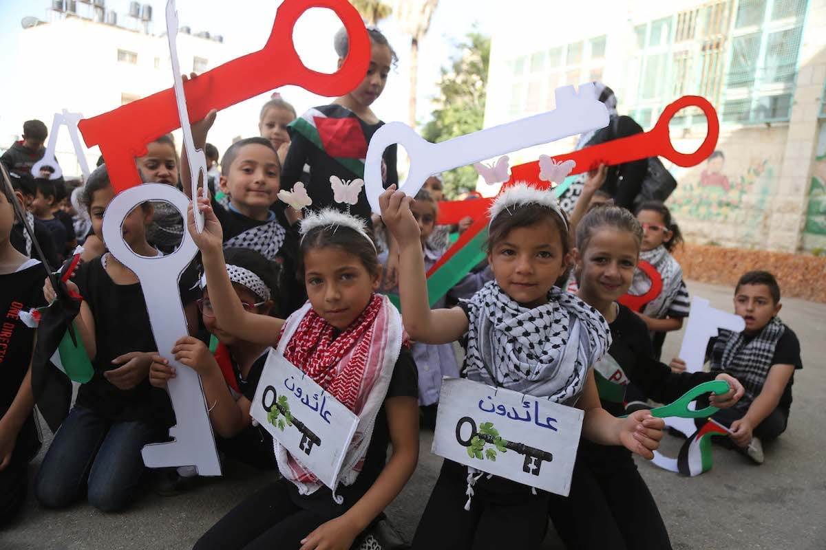Palestinian children hold model keys symbolizing the houses which Palestinians left as part of the Nakba, during a demonstration marking the 69th anniversary of Nakba, also known as Day of the Catastrophe in 1948, Ramallah, West Bank on 15 May, 2017 [Issam Rimawi/Anadolu Agency]