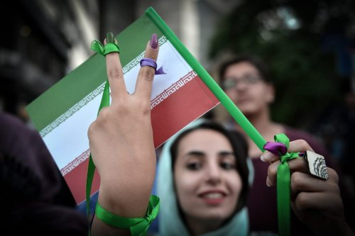 Supporters of the current Iranian President Hassan Rouhani take part in a rally in Tehran, Iran on May 15, 2017 [Fatemeh Bahrami/Anadolu Agency]