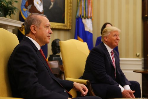 US President Donald Trump (R) and President of Turkey Recep Tayyip Erdogan (L) pose for a photo during their meeting at the Oval Office of the White House in Washington, US on 16 May 2017 [Kayhan Özer/Anadolu Agency]