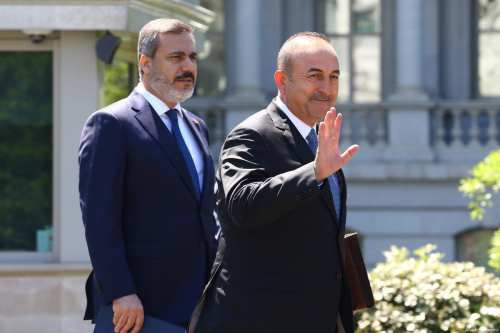 Turkish Foreign Minister Mevlut Cavusoglu (R) and Chief of Turkish National Intelligence Agency (MİT) Hakan Fidan (L) attend the meeting of President of Turkey Recep Tayyip Erdogan (not seen) and US President Donald Trump (not seen) at the Oval Office of the White House in Washington, United States on May 16, 2017 [Volkan Furuncu / Anadolu Agency]