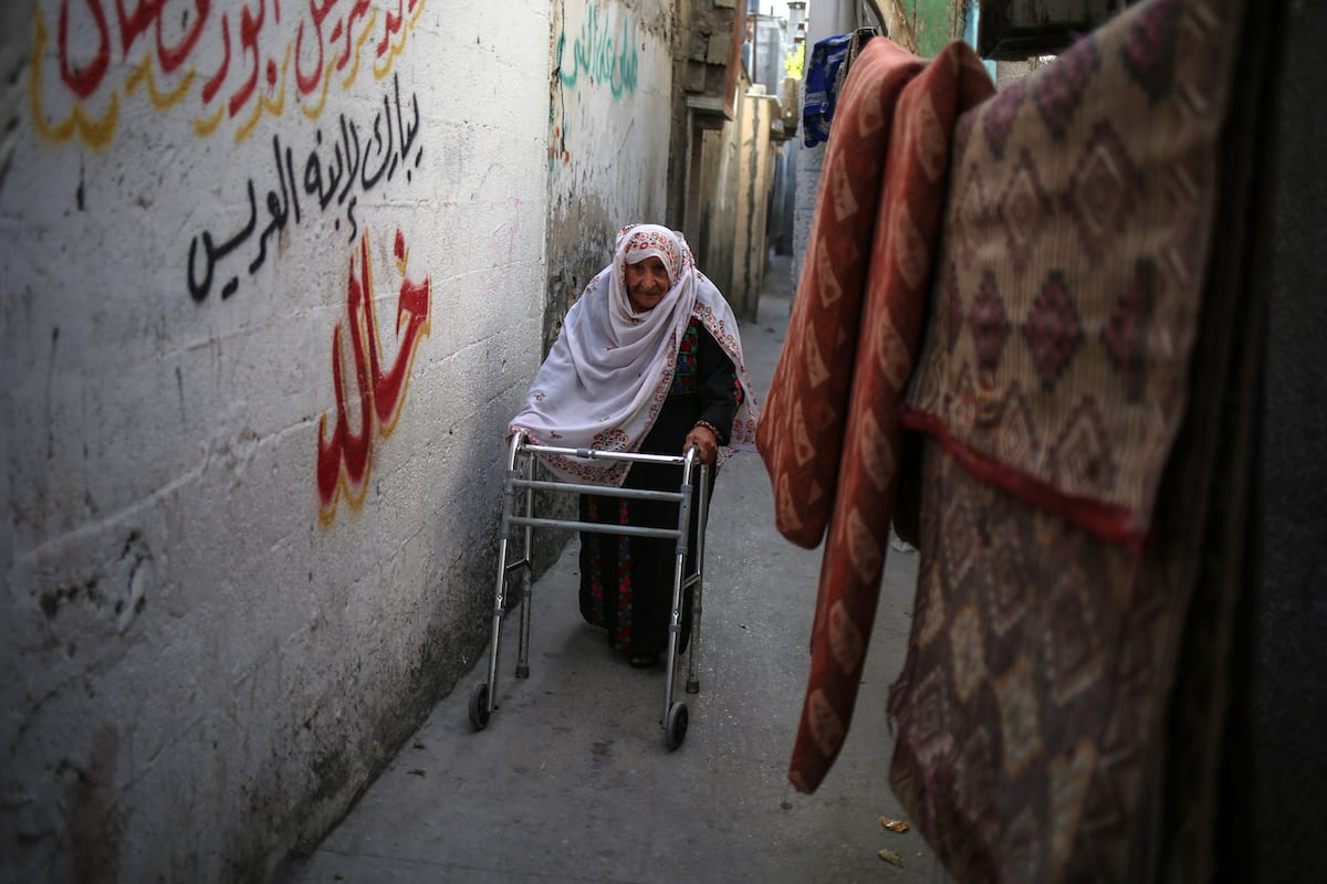 A woman uses a walker at Al-Shati Refugee Camp where displaced Palestinians take shelter after their exile from Palestine during the Nakba in 1948, is seen in Gaza City, Gaza on May 15, 2017. [Ali Jadallah - Anadolu Agency]