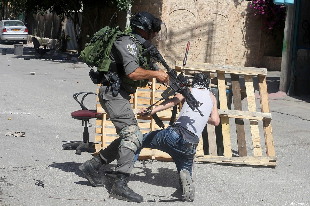 Israeli security forces clash with and detains a Palestinian protester during a demonstration to show solidarity with hunger striker Palestinian prisoners in Israeli jails at the Ni'lin village in Ramallah, West Bank on May 19, 2017 [Issam Rimawi / Anadolu Agency]