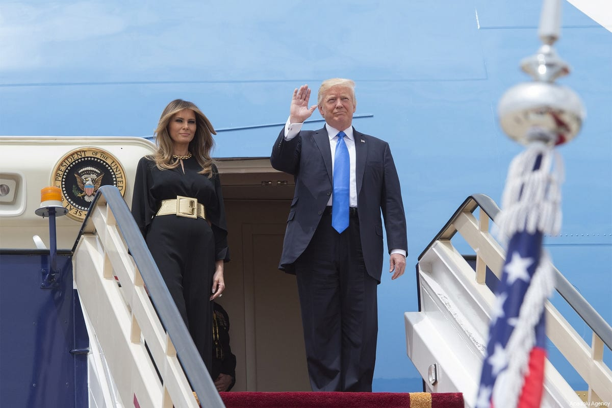 US President Donald Trump and his wife Melania Trump get off plane during their arrival at