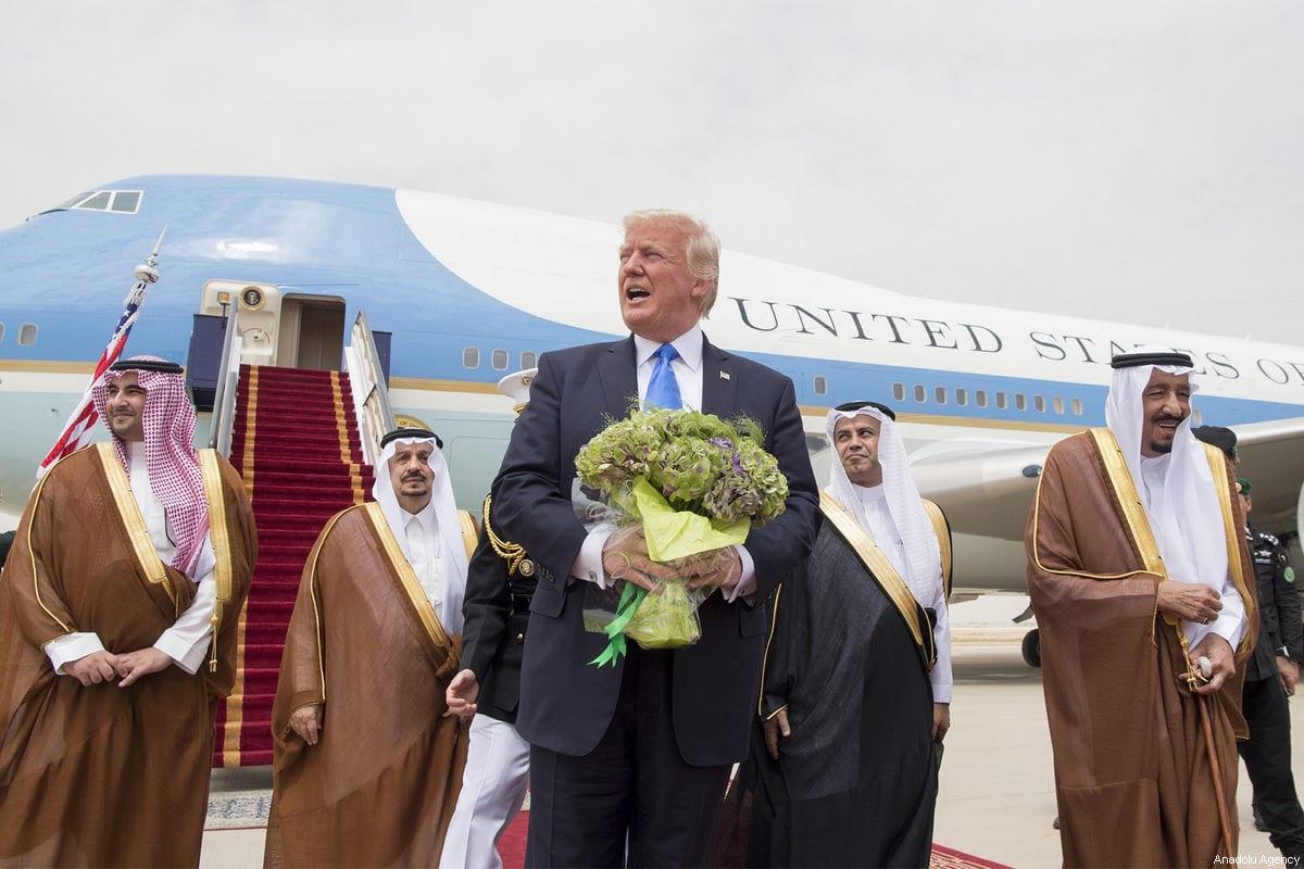 U.S. President Donald Trump (left 3) is welcomed by Saudi Arabia's King Salman bin Abdulaziz Al Saud (R) during their arrival at the King Khalid International Airport in Riyadh, Saudi Arabia on May 20, 2017. [Bandar Algaloud / Saudi Royal Council / Handout - Anadolu Agency]