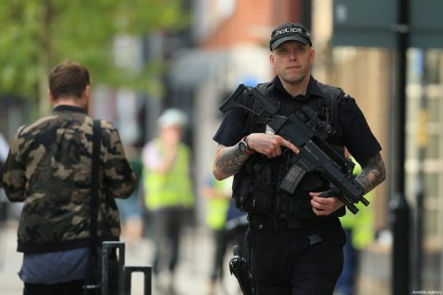British armed police patrol streets around the Manchester Arena stadium in Manchester, United Kingdom on 23 May, 2017 [Lindsey Parnaby/Anadolu Agency]