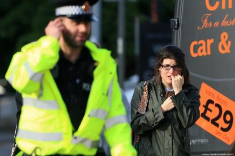 A victim looks visibly distressed as she leaves the Park Inn Hotel that took-in victims from the bomb in Manchester Arena stadium in Manchester, on 23 May 2017. [Lindsey Parnaby /Anadolu Agency]