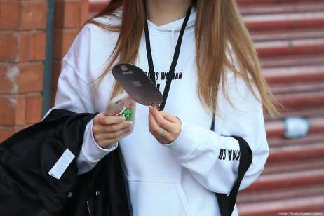 A young victim, still wearing her concert sweater and concert badge, leaves the Park Inn hotel that took-in victims from the Manchester Arena stadium in Manchester, United Kingdom on 23 May 2017. A large explosion was reported at the end of a concert by American singer Ariana Grande. [Lindsey Parnaby/Anadolu Agency]